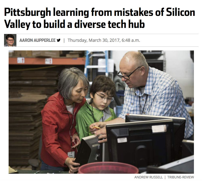 young child being taught about computer repair